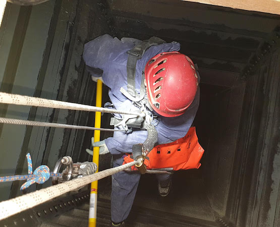 technician cleaning confined space